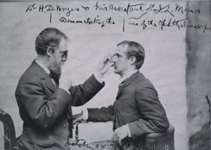Dr. H.D. Noyes & his assistant, Dr. J.L. Minor, demonstrating the use of the ophthalmoscope. ?1850s. Credits: US National Library of Medicine